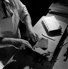 Close up of handbinding with leather  Cambridge University Press  1963.