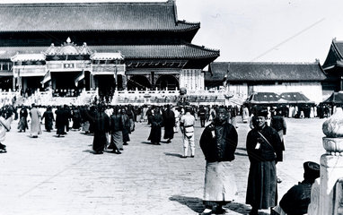 Crowd assembled outside the Imperial Palace in Peking  China  c 1910s.