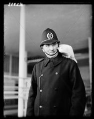 Policeman with cockatoo  1935.