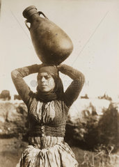 Bedouin woman carrying water  Palestine  1924.
