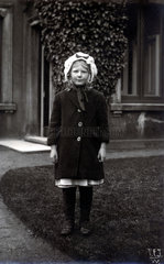Girl in winter clothing  1900s.