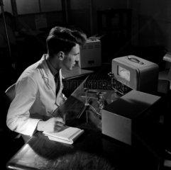 A technician tests transistors  Mullard Ltd  1956. Mitcham.