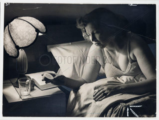 Woman taking sleeping pills  1954.