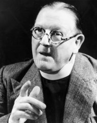 Bespectacled clergyman giving a sermon  1940s.