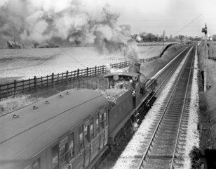 0-6-0 locomotive N0 5194 heading a local