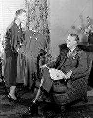 Woman showing her husband a dress  c 1950.