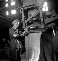 Female worker in headscarf at steel plant  Sheffield 1947.