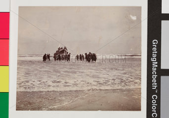 Launching of the Whitby No 2 lifeboat from the beach  c 1900s.