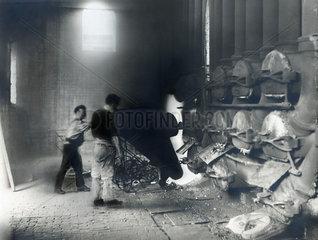 Discharging hot coke into furnaces.