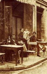 Man holding an absinthe bottle  c 1900.