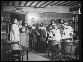 A choir rehearsing Christmas carols  Crispin Inn  Windsor Forrest  1935.
