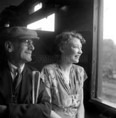 Passengers in a railway carriage  1950.