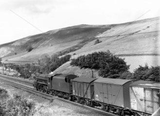 Steam heated banana vans in transit  Lake District  c 1950.