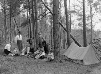 A group of campers cooking food  New Forest  England  9 May 1931.