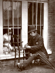 'Caney the Clown' mending chairs  1877.