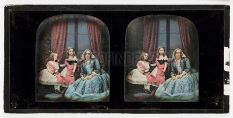 Stereo-daguerreotype of a woman and two children  1855.