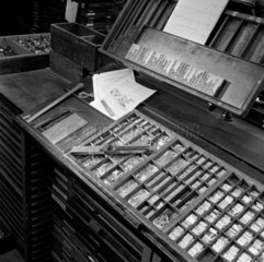 Still life study of printers showing lead type in boxes. Sellar and Sellar  1953.