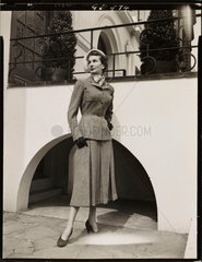 Fashion study: woman in a tweed suit  1960s.