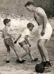 Jock Stein  Scottish footballer  playing football with two boys  1955.