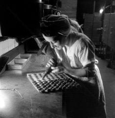 Woman making chocolates at Mackintosh Ltd  Halifax  1950.
