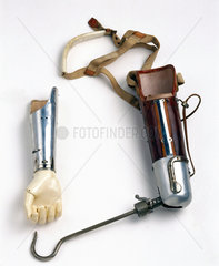 Artificial arm with hook and forearm attachments  c 1924-1930.