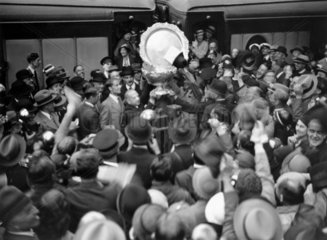The victorious Davis Cup tennis team with trophy  Victoria Station  31 July 1933.