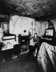Mother and child in their slum property  Liverpool  21 November 1949.