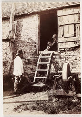 By the grindstone  c 1890.