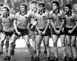 Wolverhampton Wanderers guard against a Liverpool free kick  1980s.