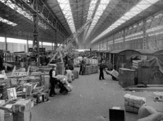 Porters at work  Paddington Station goods depot  London  May 1927.