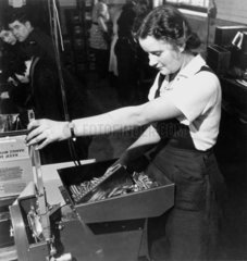 Woman sorting bullets for the Royal Air For