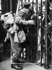 Soldier kissing his wife through railings  Second World War  15 May 1940.