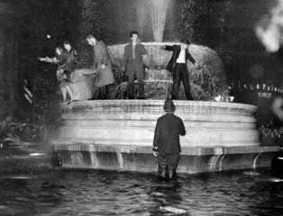 People in the fountain in Trafalgar Square  31 December 1958.
