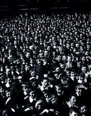 Crowd of schoolchildren in a playground  c 1920s.
