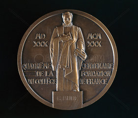 Medal celebrating the 400th anniversary of the College de France  Paris  1930.