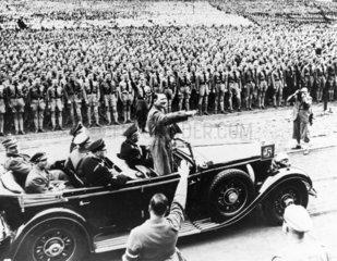 Adolf Hitler (1889-1945) saluting  1 May 1936.