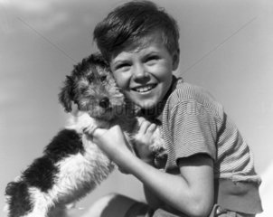 Young boy with a dog  c 1930s.