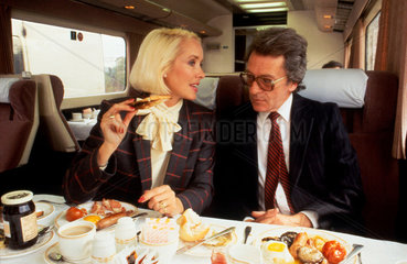 Executive passengers eating breakfast in Pullman dining car  c 1980s.
