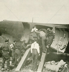 Unloading a jeep from a Fedden Mission's Dakota aircraft  June 1945.