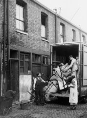 Home removals  c 1930s. Loading the bed int