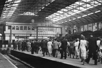 Passengers arriving at Liverpool Street station  London  9.00 am  29 June 1949.