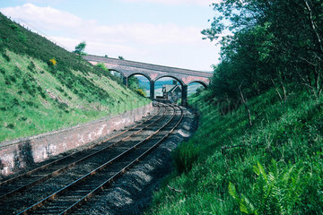 Railway line  with station in the distance.