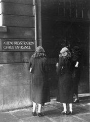Three women outside the 'Alien Registration Office entrance'  late 1920s.