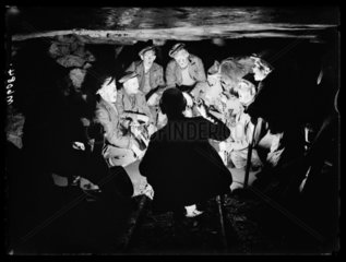 Welsh miners singing carols  1943.
