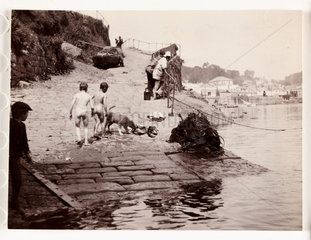 Two boys after a swim  Whitby Harbour  North Yorkshire  c 1905.