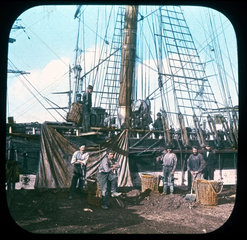 Men working on a ship  c 1895.