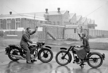 A man and a girl on Excelsior motorcycles w