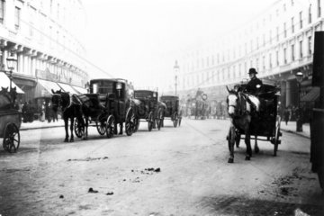 Horse-drawn carriages  Regent Street  Londo