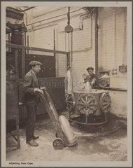'Adjusting Nose Caps'  Cunard Munition Works  Liverpool  1914-1918.