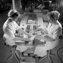 Two women pack pharmaceutical supplies  CIBA  Horsham  1960.